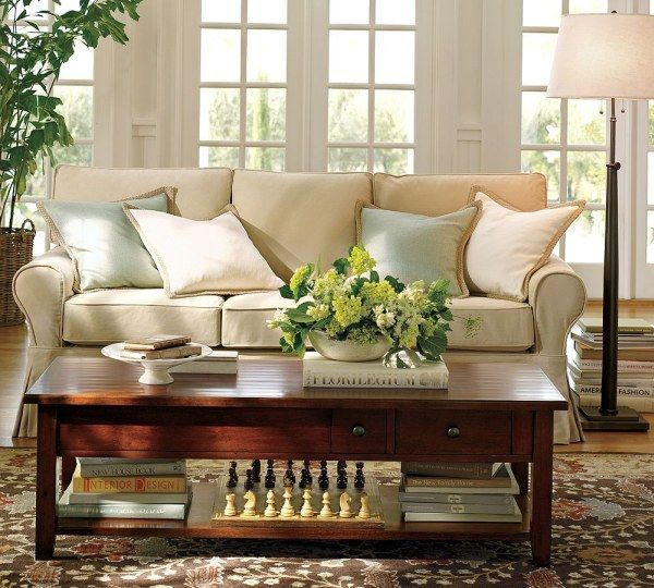 Floral-Carpet-Lacquered-Wood-Table-Artificial-Flowers-Cushy-White-Sofa-living-room-ideas