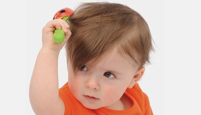 Little baby combing hair