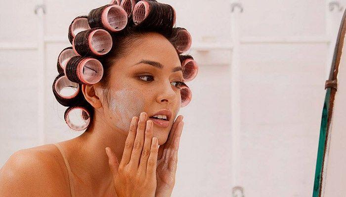 Girl smears face cream